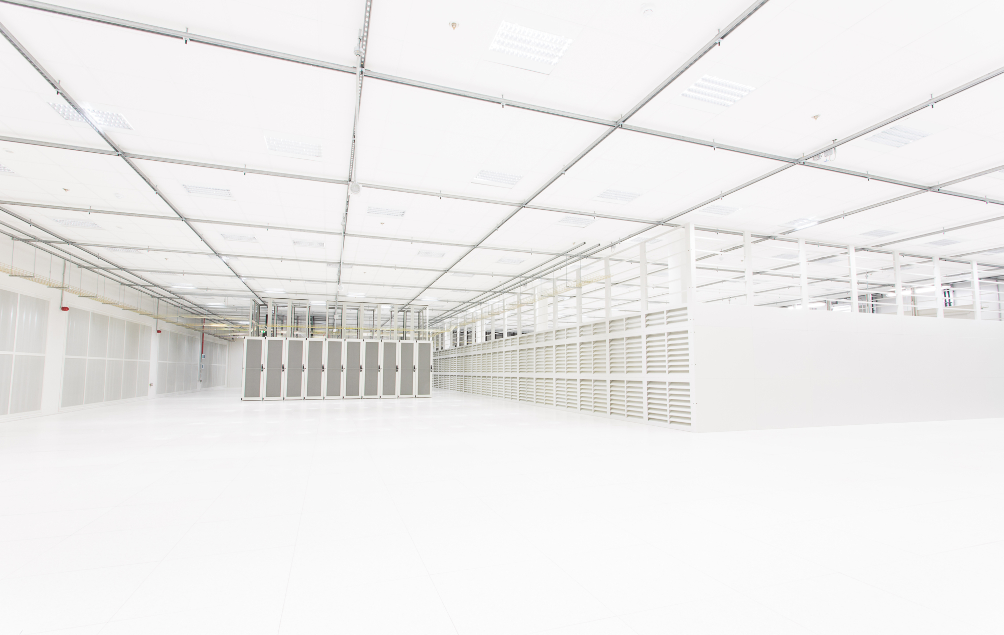 Image showing the inside of a computing warehouse, in white and faint tones.
