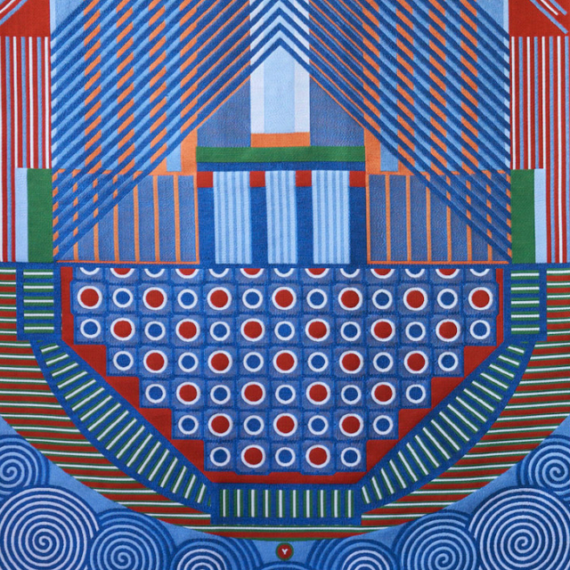 Two colourful wall tapestry wall hangings with mainly blue and red geometric patterns.