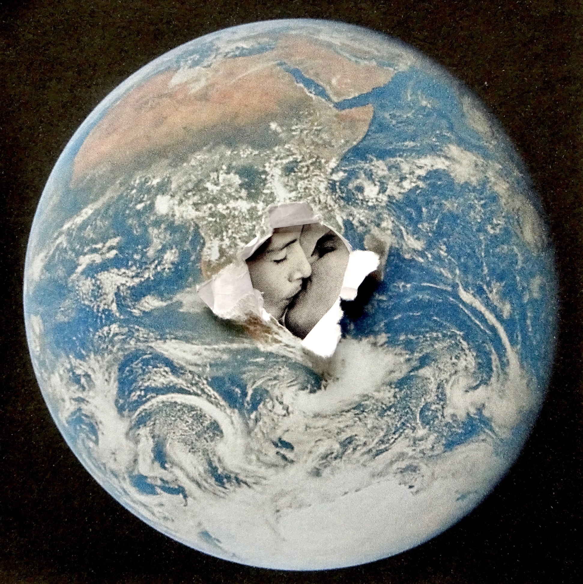 A collage with an image of the earth and a kissing couple that is bursting out in the centre.
