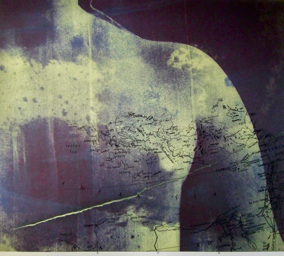 Photograph of a woman's torso with a map superimposed onto it in muted blue and yellow.